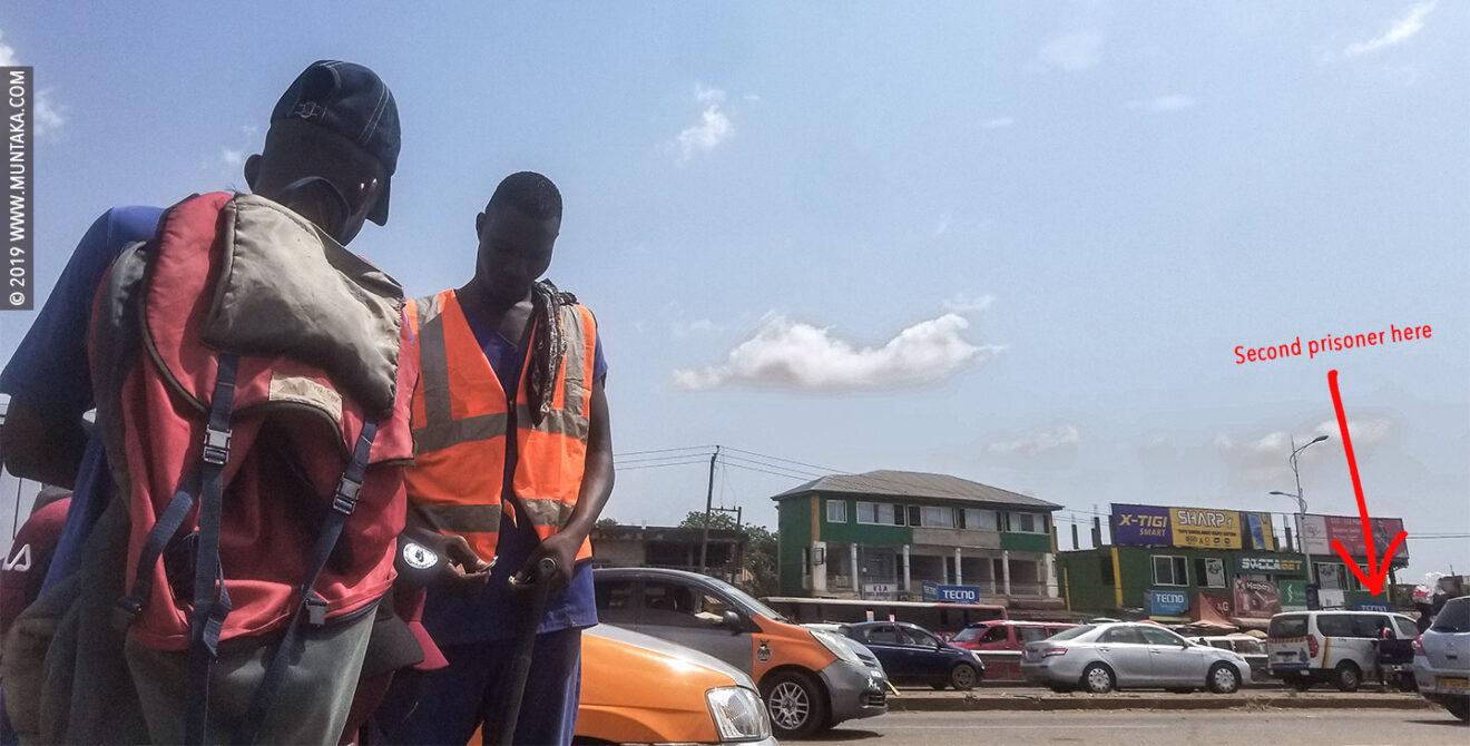 Ghana Prisoner Holding A Shovel and Panhandling for Money on the Street of Accra, Ghana.