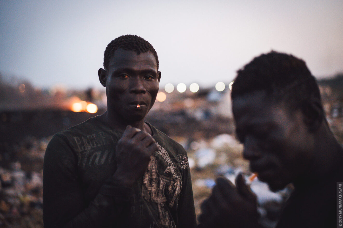 Men smoking portrait by Muntaka Chasant