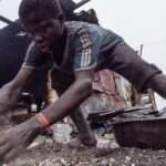 scrap worker at Agbogbloshie, Ghana