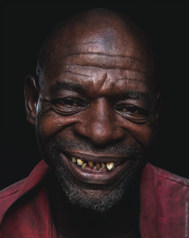 Smiling Man Portrait by Muntaka Chasant