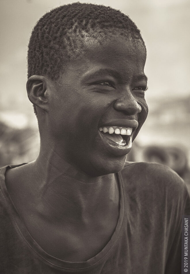 #half Laughing boy: A poor urban boy is having a good laugh in Accra, Ghana.t rate in Ghana is highest among those aged 15-24 years. Over 40% of people between 15 – 35 in Ghana have no education, thus forced to fend for themselves in the informal sector, doing all sorts of hazardous works. © 2019 Muntaka Chasant
