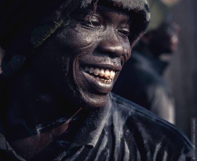 Smiling urban portrait by Muntaka Chasant
