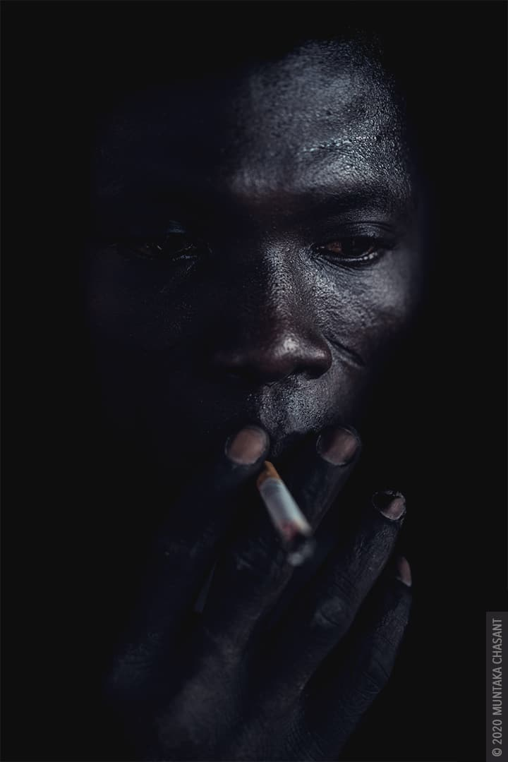 Smoking man portrait by Muntaka Chasant