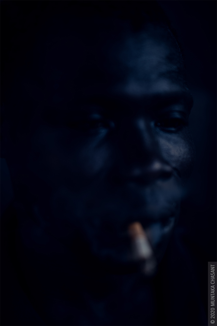 Smoking urban man in Ghana by Muntaka Chasant
