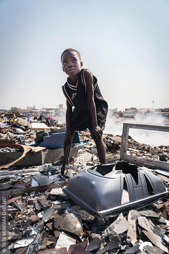 Agbogbloshie children: Kwadwo is a 9-year-old boy engaged in hazardous child labour at Agbogbloshie, Ghana. © 2020 Muntaka Chasant