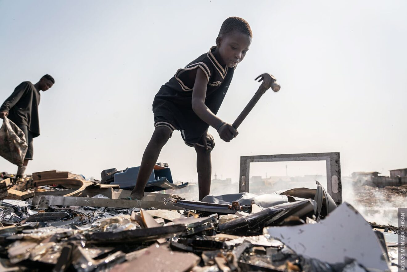 Child labour: 9-year-old Kwadwo is using a hammer to break apart a cathode-ray tube-based TV for the iron materials inside at Agbogbloshie, Ghana. This exposes him to dangerous levels of lead. © 2020 Muntaka Chasant