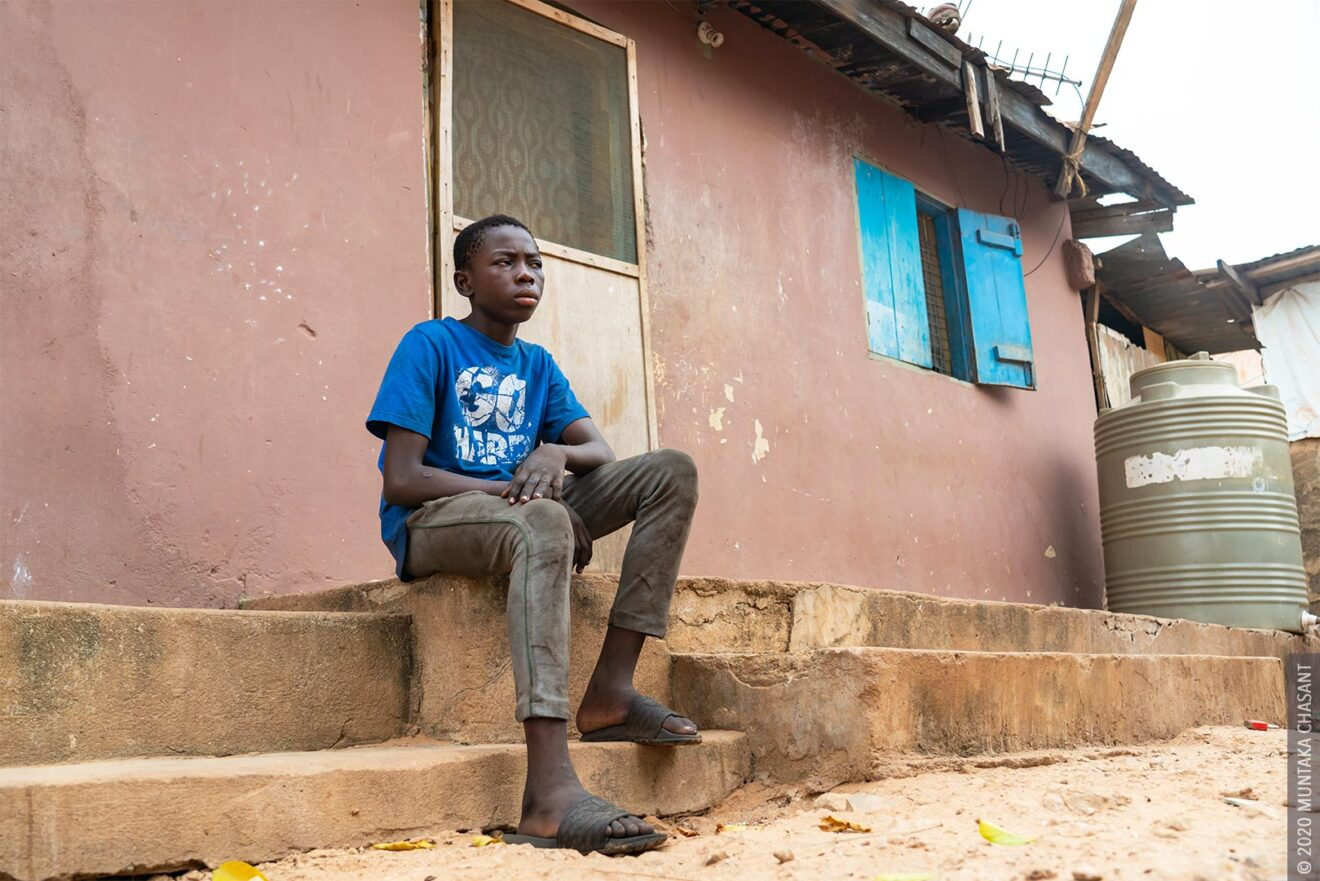 Malik, 14 years, now home in his family's house at Madina, Accra. February 19, 2020. © 2020 Muntaka Chasant