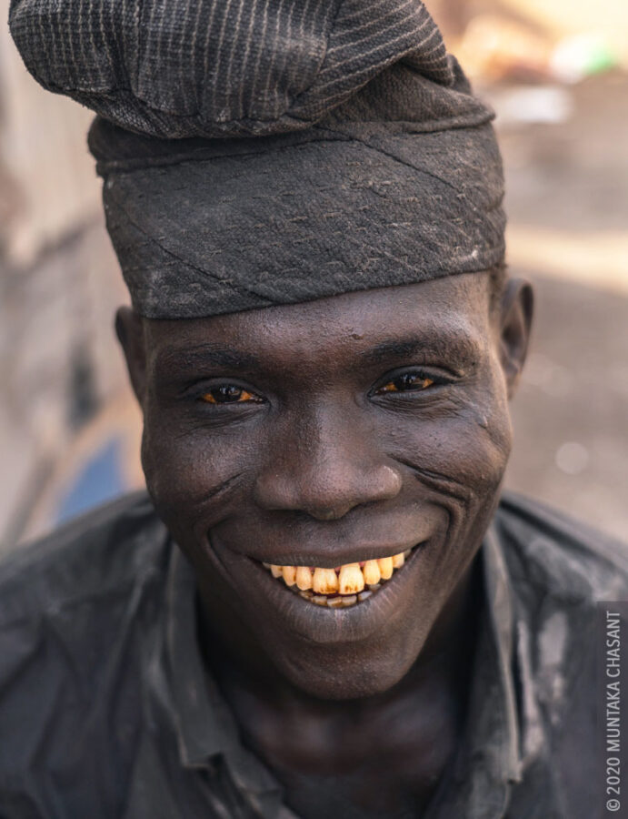 Man Smiling Photo: An urban man smiling at the camera. © 2020 Muntaka Chasant