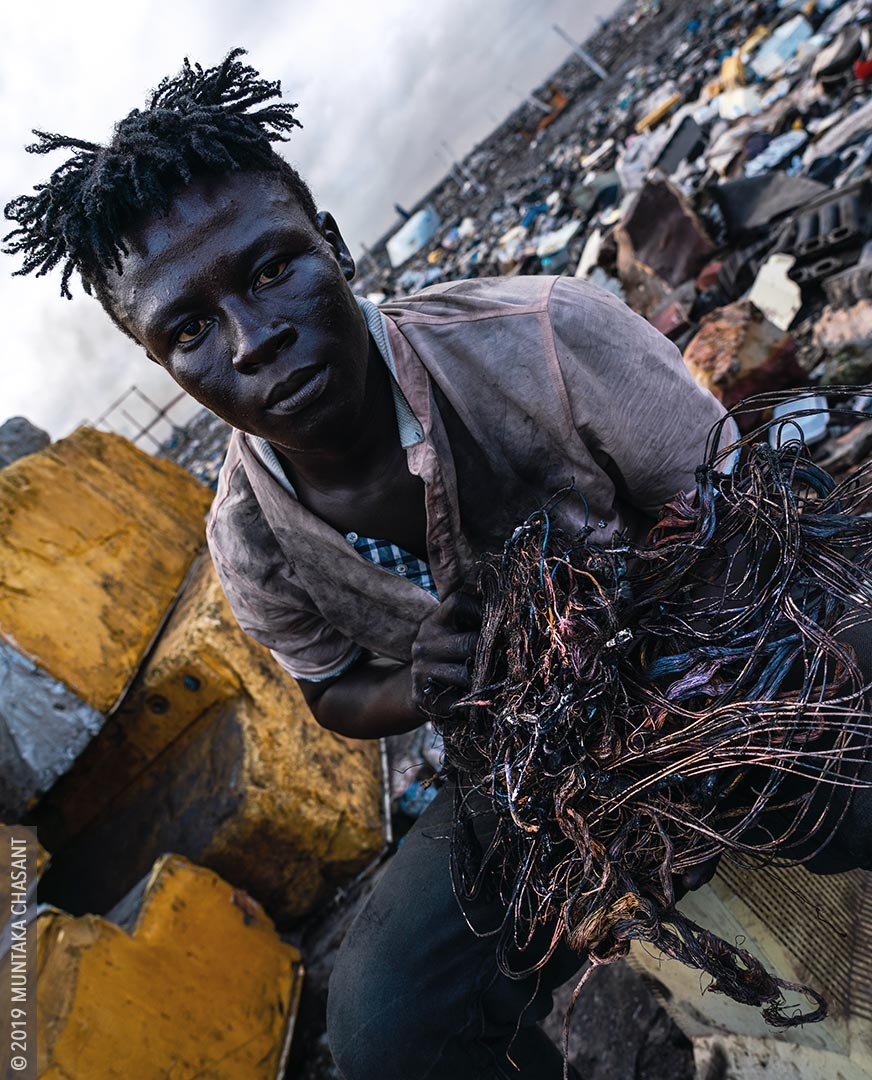 A 'burner boy' displaying freshly recovered copper wires at Agbogbloshie, Ghana. A pound of copper at Agbogbloshie sold for around GH₵10 (roughly $1.7 at that time) as of March 2020. © 2019 Muntaka Chasant