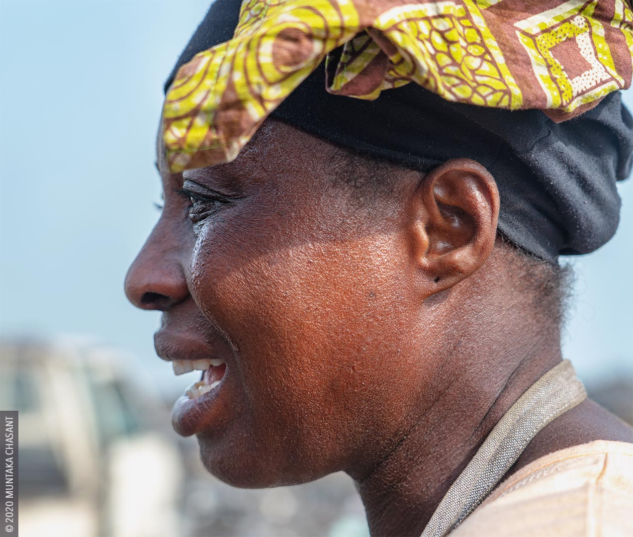 Urban Poverty: Poor Woman Crying Photo in Accra, Ghana. © 2020 Muntaka Chasant