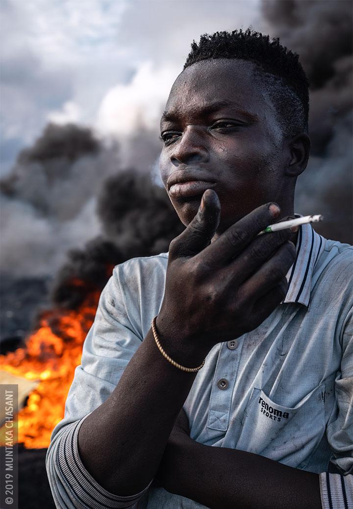 Urban Miner Smoking / Agbogbloshie, Ghana. © 2019 Muntaka Chasant