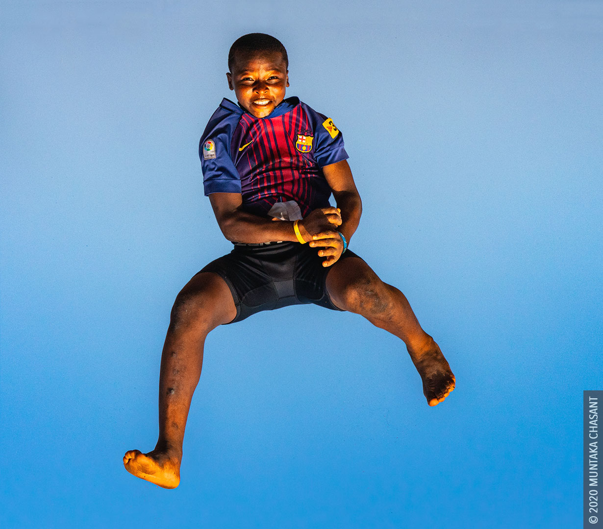Slum Children in Africa: Urban poor boy playing at Agbogbloshie, Ghana. © 2020 Muntaka Chasant