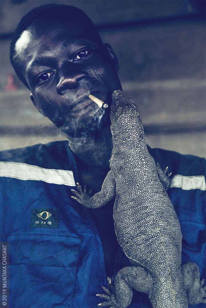Urban slum dweller smoking photo. Millions of young people in Africa flee rural poverty to urban slums, where they lack access to basic utilities and security. © 2019 Muntaka Chasant