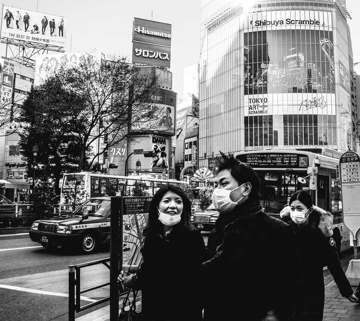 Tokyo street photography: Man and two women near the Shibuya scramble crossing in Tokyo, Japan. © 2016 Muntaka Chasant