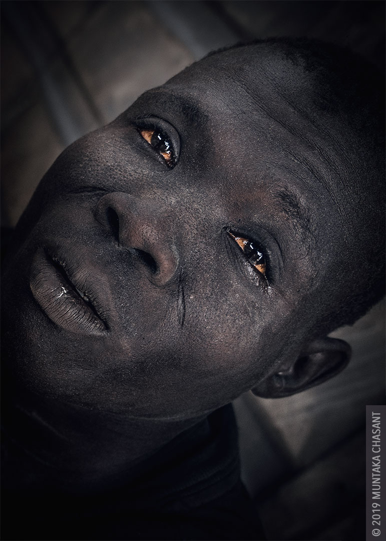 Poverty picture: Portrait of a struggling urban man in Accra, Ghana. Many urban poor who live in urban slums lacks access to safe water and healthcare. © 2019 Muntaka Chasant
