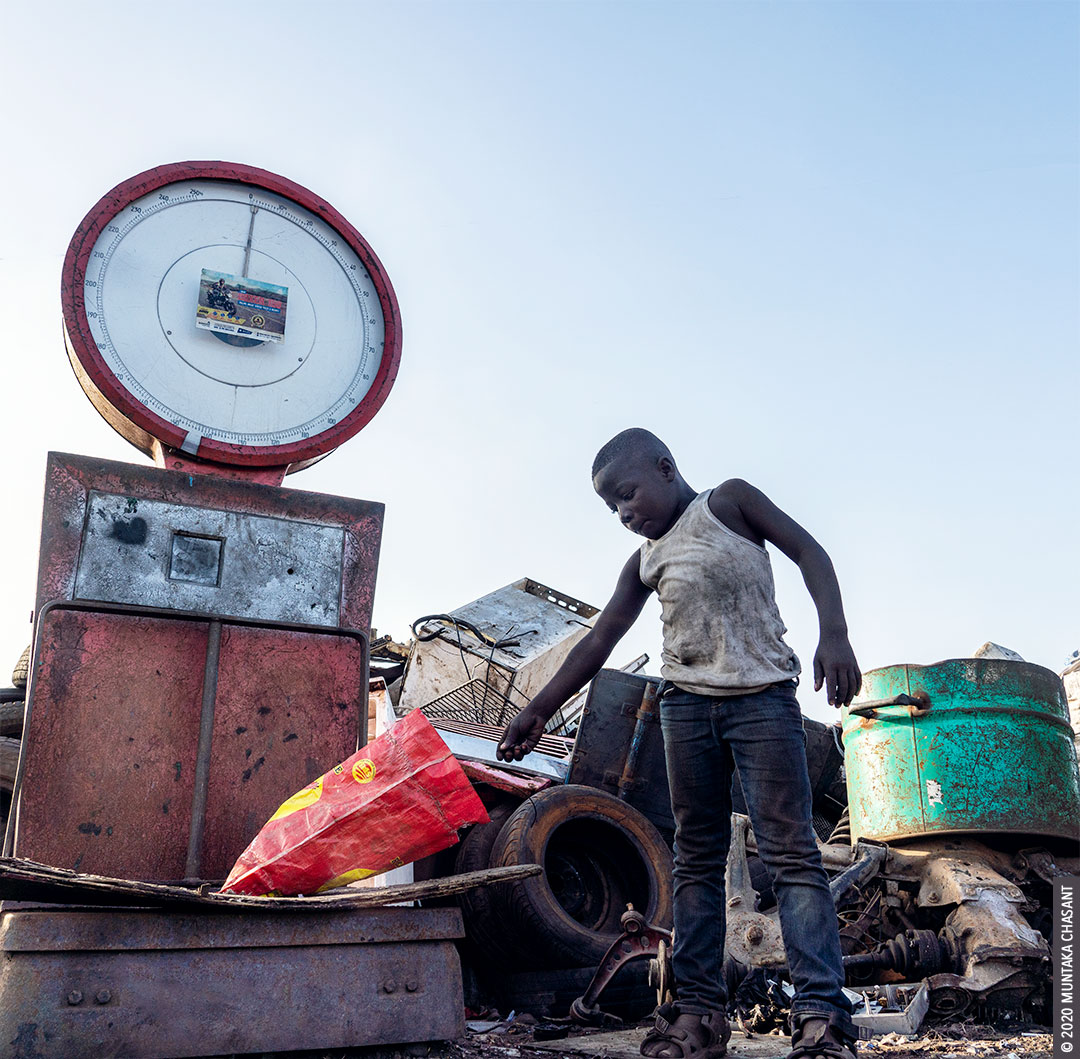 Agbogbloshie child labour: An 8 years old hazardous child labourer is weighing scrap metals at Agbogbloshie, Ghana. Hundreds of urban poor children live and work in hazardous conditions Accra, Ghana's capital city. © Muntaka Chasant