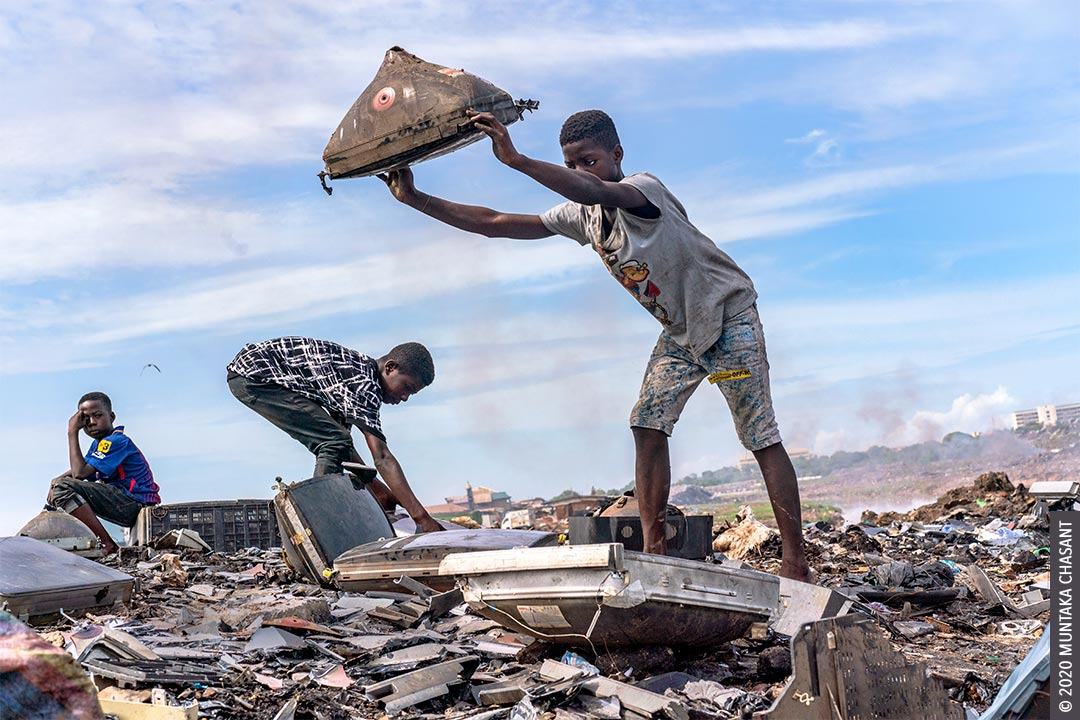 Agbogbloshie children: Kwaku Debrah, 15 years old, is just about to smash an old CRT TV against a rock to recover the shadow mask and other iron materials inside. Debrah is one of many children engaged in hazardous child labour at Agbogbloshie, Ghana. © 2020 Muntaka Chasant