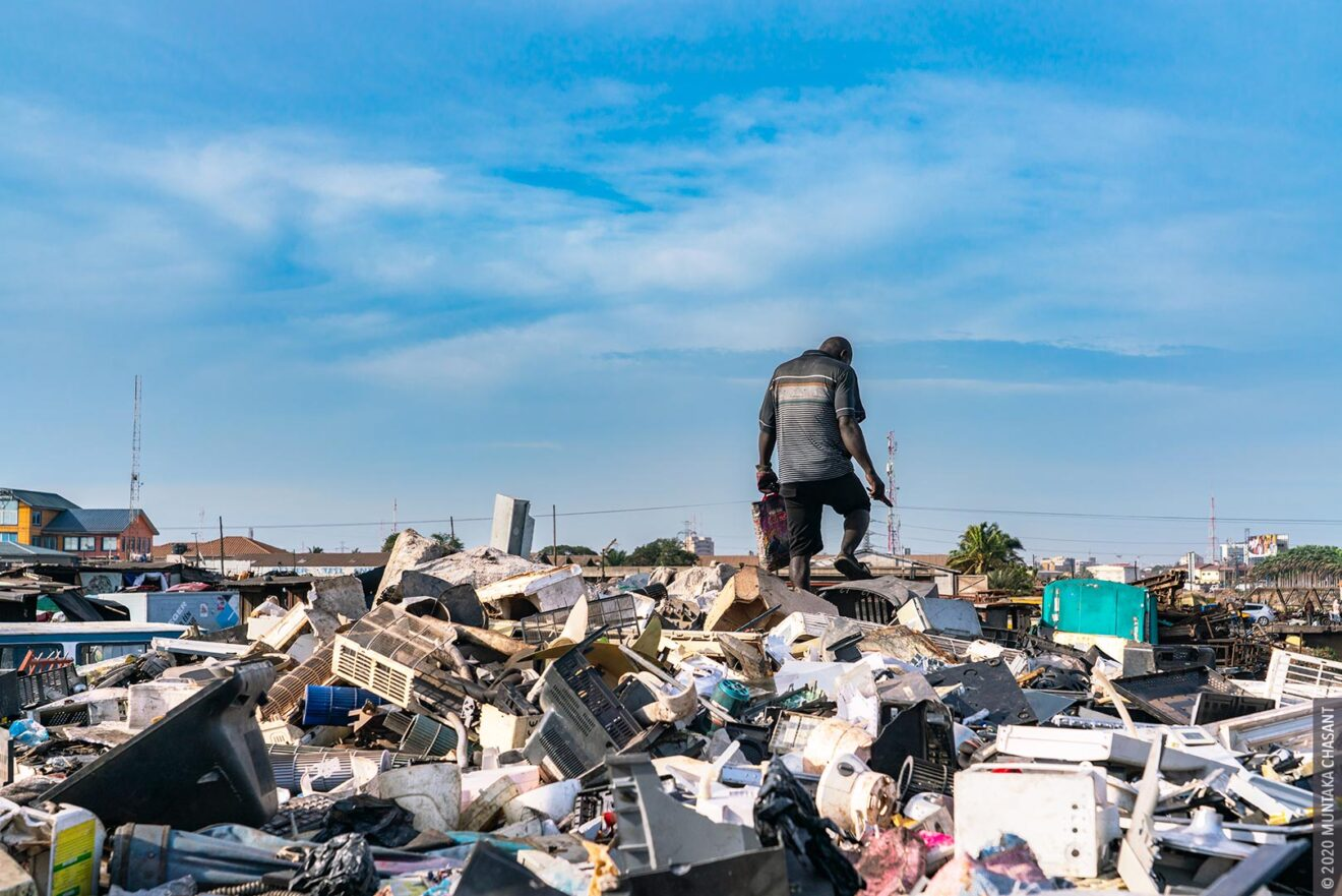 Urban Poverty: A young urban poor man is searching for e-waste components on an e-waste dumpsite at Agbogbloshie, Ghana. © 2020 Muntaka Chasant