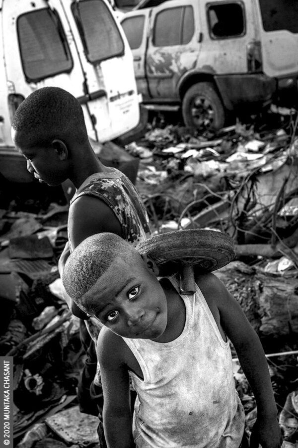 Child Labour: An 8-year-old boy engaged in hazardous child labour is having fun on an e-waste dump at Agbogbloshie, Ghana. Around 19 million children below the age of 12 years are in hazardous child labour worldwide, the ILO statistics show. UNICEF estimates that nearly 2 million children in Ghana aged 5-17 years are in child labour. About 385 million children worldwide live in extreme poverty and survive on less than $2 a day, according to UNICEF. This represents about half of the world's extreme poor. © 2020 Muntaka Chasant