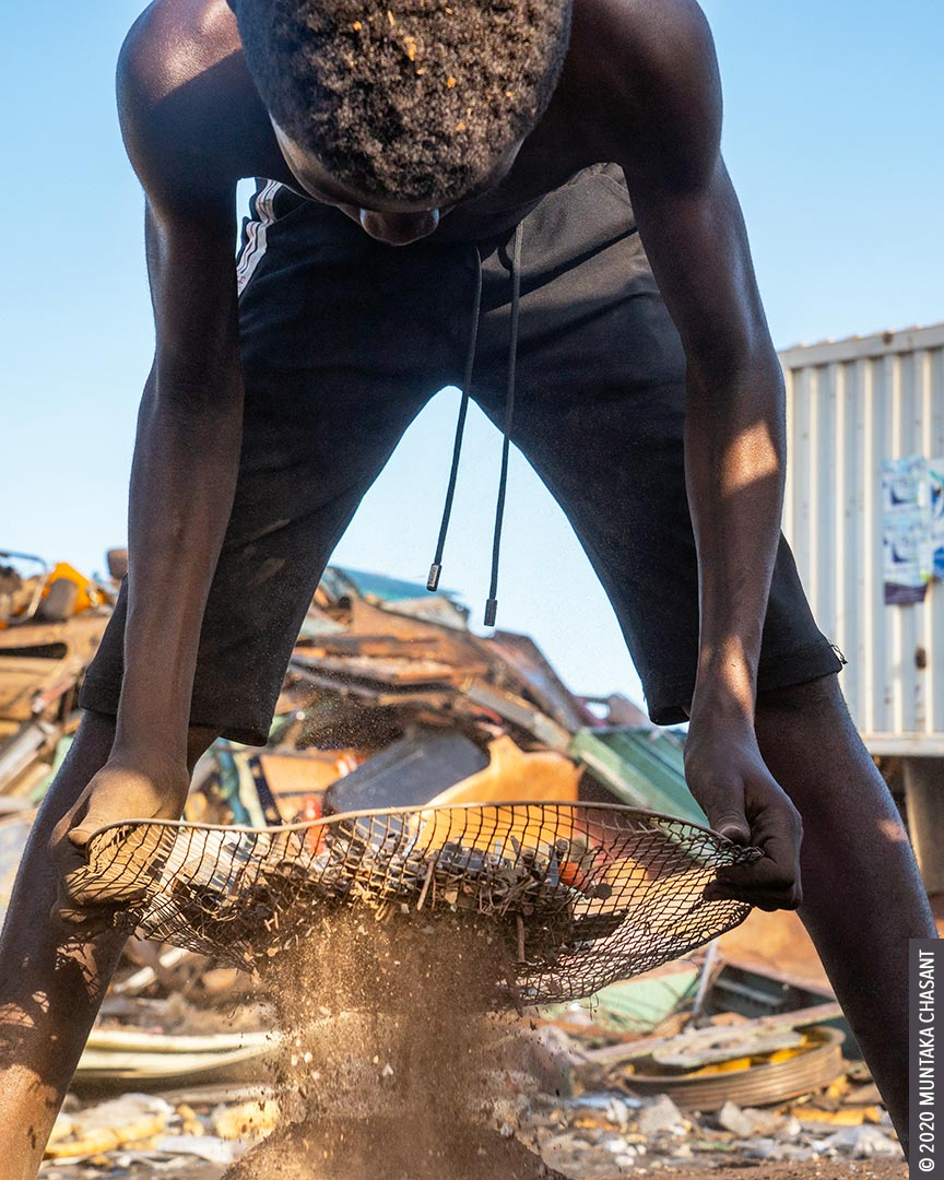 Child labour in Africa: 15-year-old boy is sifting dirt from nails and other small metals before they are sold at Agbogbloshie, Ghana. More than 30 million children in Africa are engaged in hazardous work, according to the 2016 Global Estimates of Child Labour report. © 2020 Muntaka Chasant