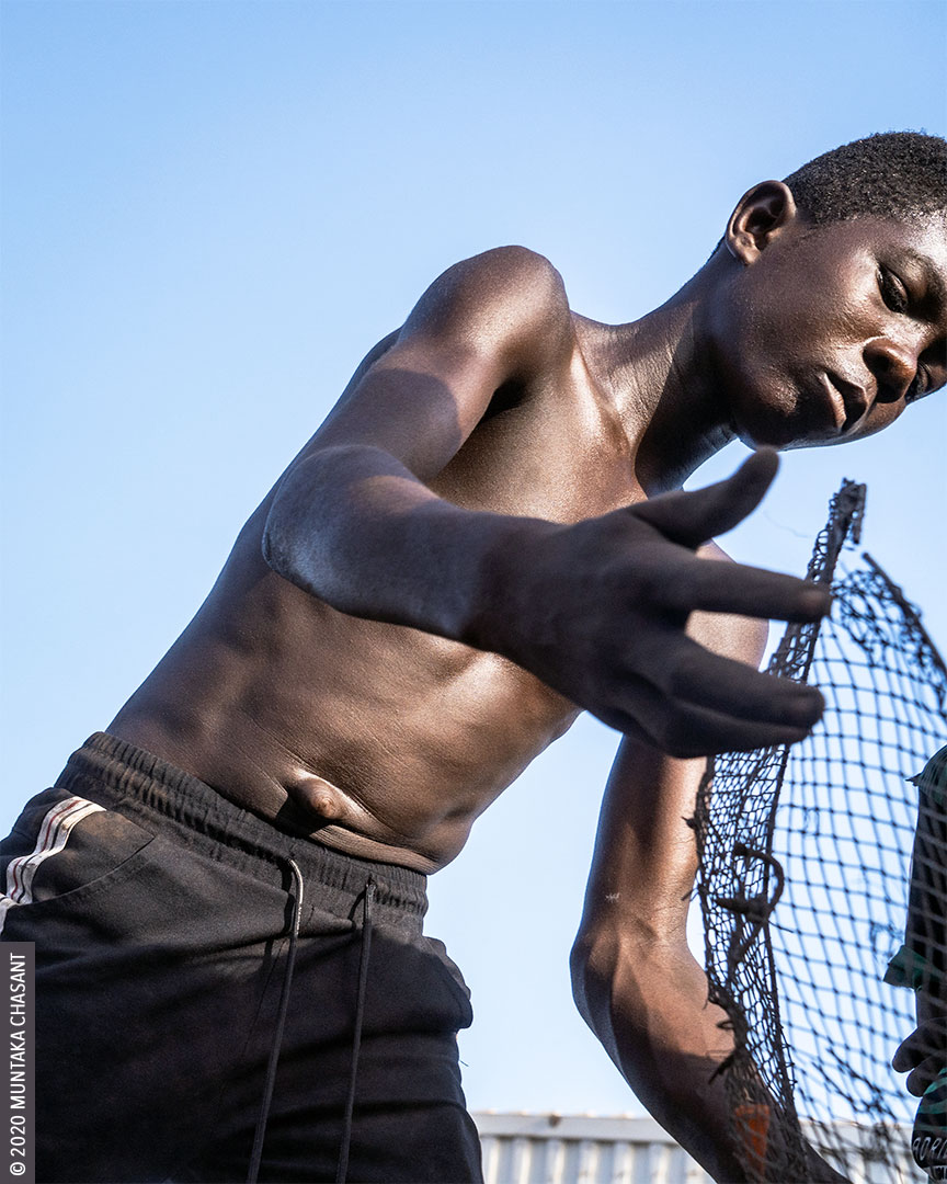 Child labour at Agbogbloshie: A 15-year-old boy is engaged in hazardous work at Agbogbloshie, Ghana. The minimum age for hazardous work in Ghana is 18, according to Section 91 of Ghana's Children's Act (560). © 2020 Muntaka Chasant