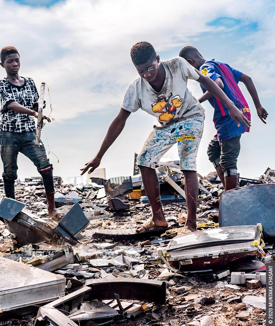 Child labour image: Kwaku Debrah, a 15 years old adolescent, has just smashed an old CRT TV against a rock to reclaim the iron materials inside at Agbogbloshie, Ghana. A piece of CRT glass stuck in his hair fell past his left eye, overshadowing it. Debrah is already blind in the left eye and wears a prosthetic. More than 60% of children in hazardous work worldwide are boys, according to ILO estimates. © 2020 Muntaka Chasant