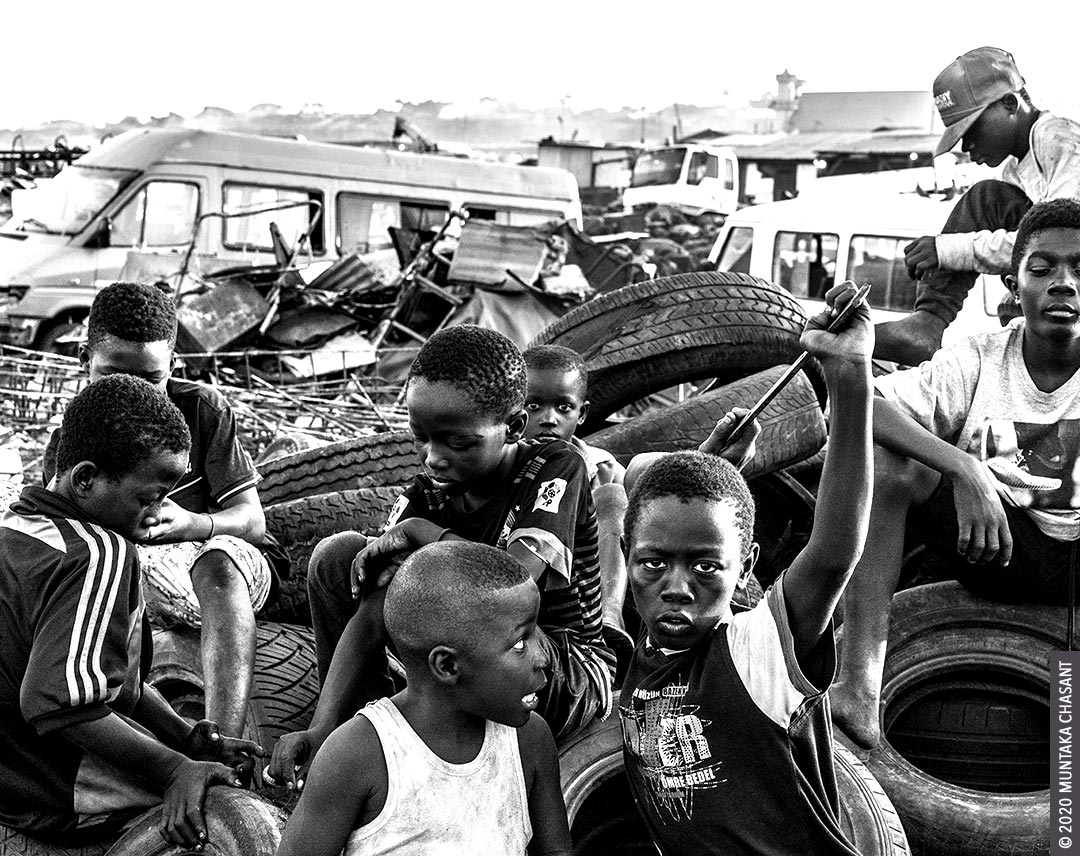 Hazardous child labourers hang out on an e-waste dump at Agbogbloshie, Ghana. Around 73 million children between 5 and 17 years worldwide are in hazardous child labour, the ILO statistics show. © 2020 Muntaka Chasant