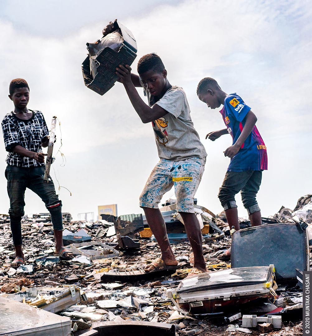 Child labour: A 15-year-old adolescent boy about to smash an old CRT TV against a rock to recover the iron materials inside at Agbogbloshie, Ghana. © 2020 Muntaka Chasant