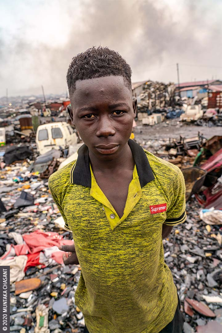 Joseph Akwah is a 17 years old poor boy engaged in hazardous child labour on the fringes of Agbogbloshie, Ghana. © 2020 Muntaka Chasant