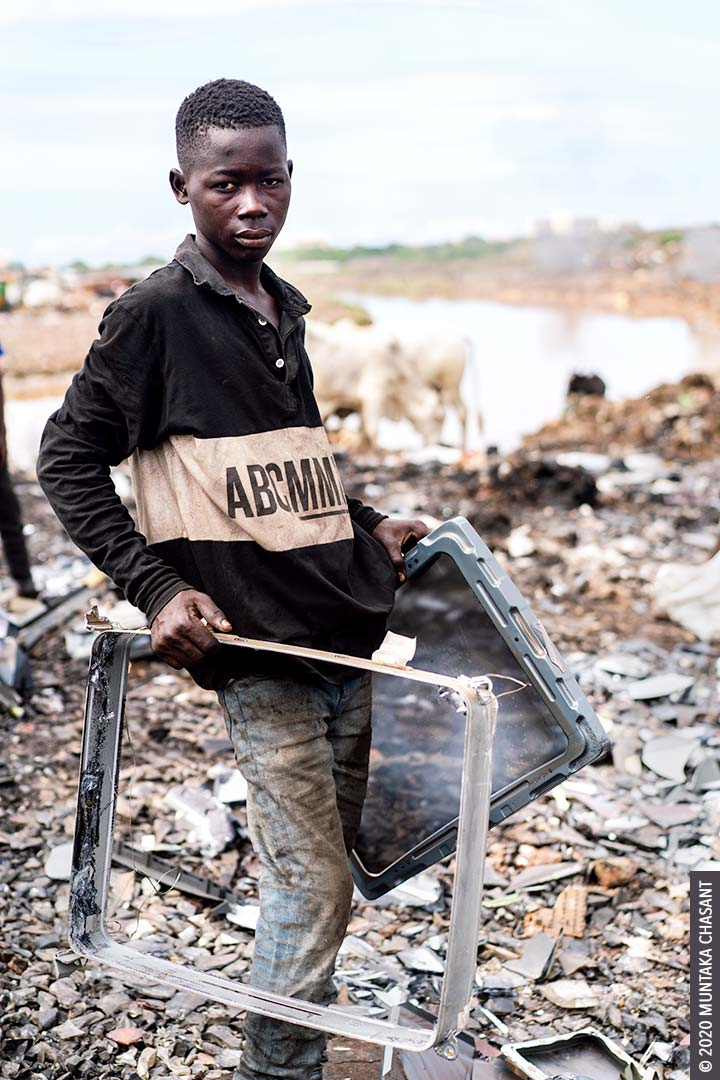 A 17-year-old adolescent boy had just reclaimed iron materials from an old CRT TV at Agbogbloshie, Ghana. © 2020 Muntaka Chasant