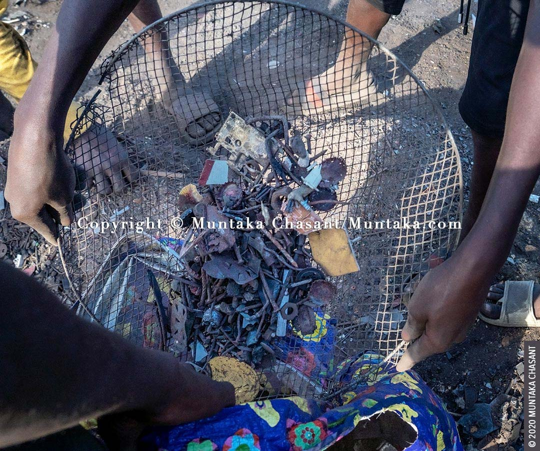 Child labour: Nails and other small metals are being processed before they are weighed and sold at Agbogbloshie, Ghana. © 2020 Muntaka Chasant
