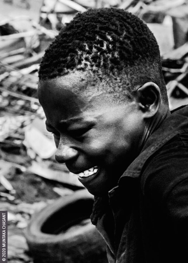 Pain and struggle image: Photograph of a young man in a desperate struggle to survive in a cold, harsh urban environment. Copyright © 2020 Muntaka Chasant