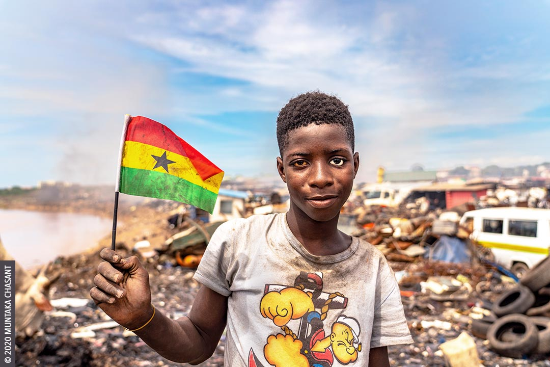 Kwaku Debrah, pictured above holding a Ghana flag, is a 15 years old adolescent boy engaged in hazardous work on the margins of Accra, Ghana's capital city. African broomstick punctured his eye ball when he was 9 years old. He's blind in the left eye and wears a prosthetic. © 2020 Muntaka Chasant