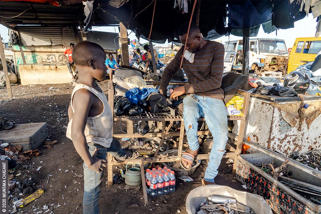 Child Labour: 8 years old child labourer Akufo-Addo waits to receive money for selling scrap metals at Agbogbloshie. © 2020 Muntaka Chasant