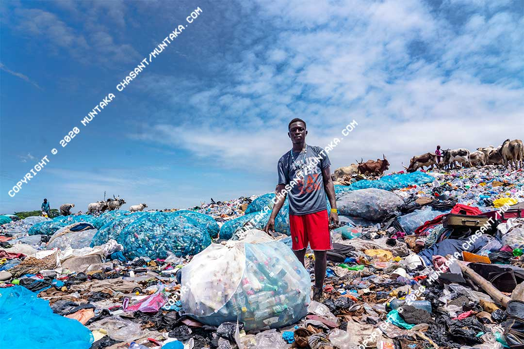 Plastic pollution and the urban poor: An urban poor man displays his collected plastics at a dumpsite in Accra, Ghana. Copyright © 2020 Muntaka Chasant