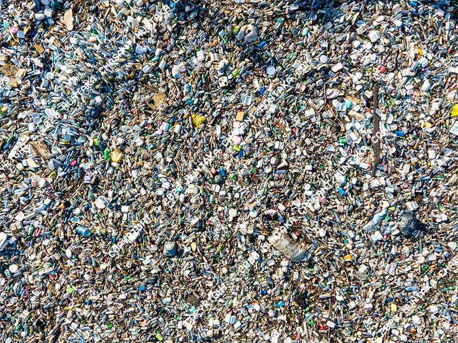 Plastic pollution: Man is barely visible from a bird's eye perspective as he collects plastics from the heavily polluted Korle Lagoon in Accra, Ghana. The plastics sold for around $0.17 per kilo, but the coronavirus pandemic has crippled plastic recycling worldwide. More than 250 million tonnes of plastic waste is generated worldwide every year. Copyright © 2020 Muntaka Chasant