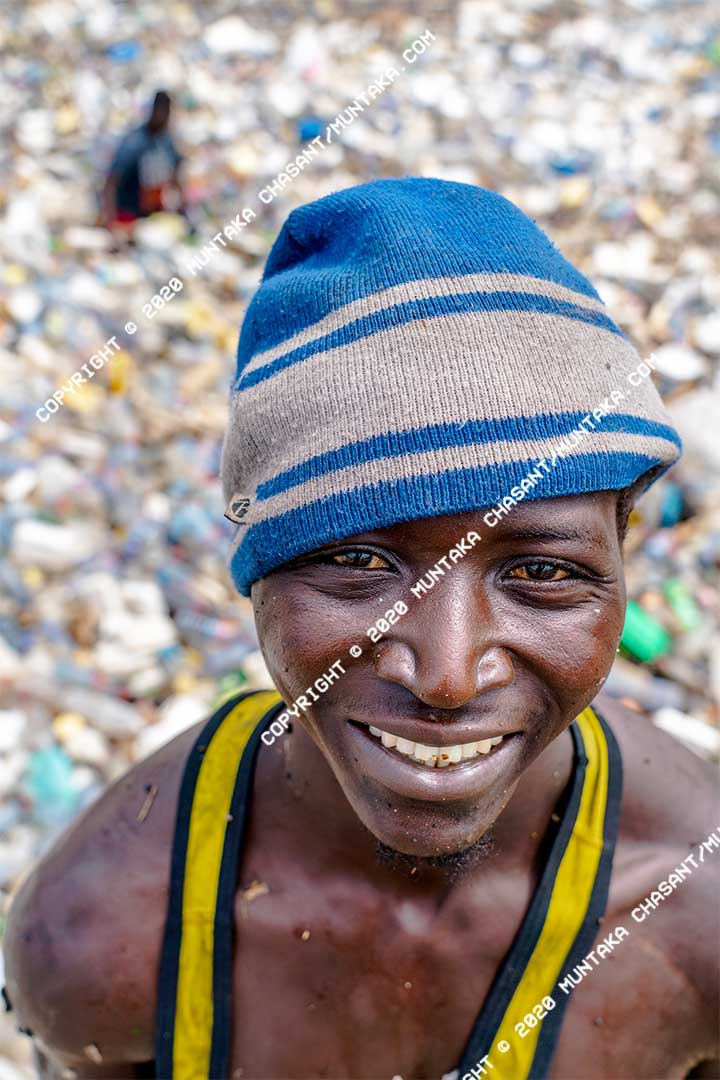 An urban poor man who swims in the polluted Korle Lagoon to collect plastic waste smile for the camera. Accra, Ghana. Copyright © 2020 Muntaka Chasant