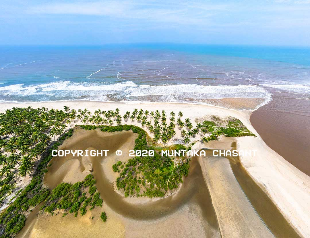 Amisa Estuary: Aerial view of the Amisa estuary near Amissano, a Fishing Village in the Central Region, one of Ghana's southern regions. Copyright © 2020 Muntaka Chasant