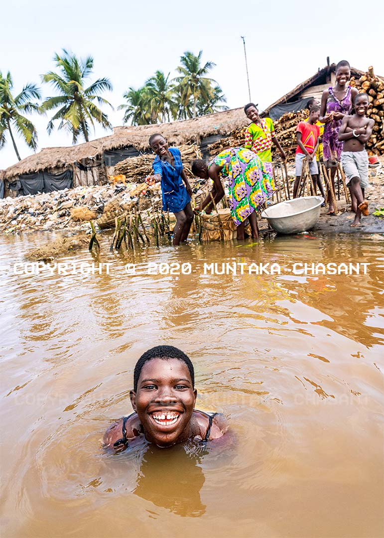 Climate change and poverty: Young women at a Fishing Village in Ghana sell blue crabs to earn an income amid limited resources and a decline in fish catch caused by many factors, including climate change. Ocean warming is disrupting the livelihoods of fishers along Ghana's coastlines. They are pushed into poverty when they cannot work and earn an income. Copyright © 2020 Muntaka Chasant