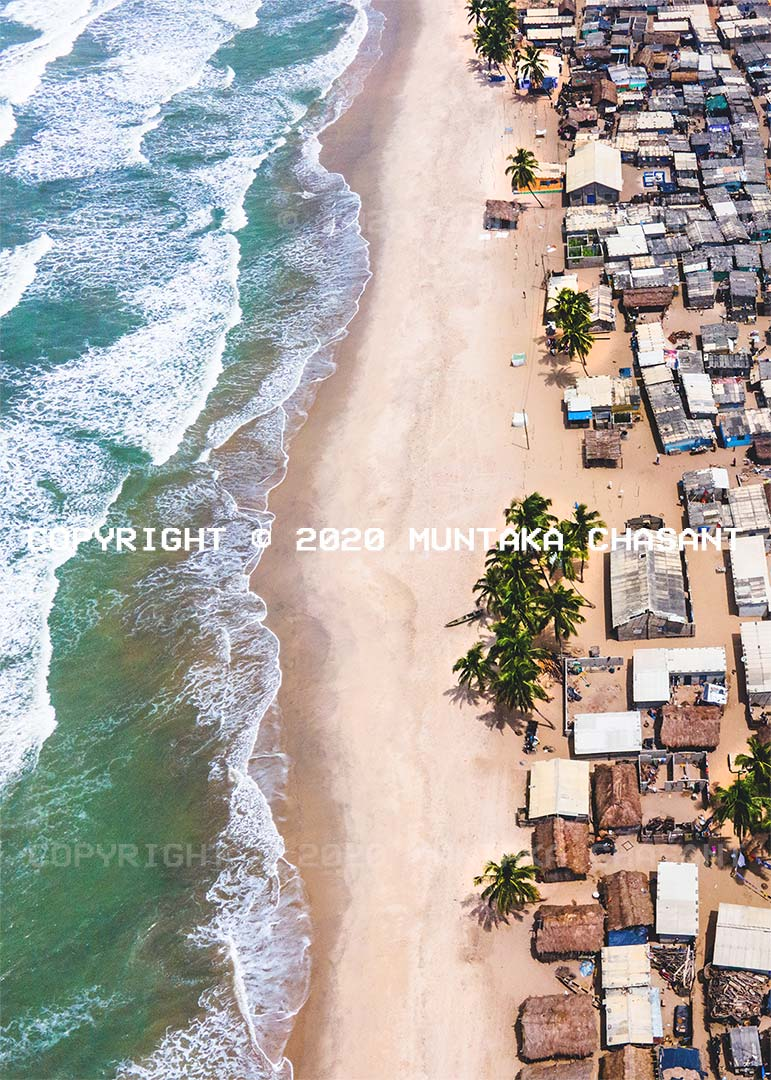 Climate change photography: Aerial view of a fishing village (in Ghana) at the front line of climate change. Copyright © 2020 Muntaka Chasant