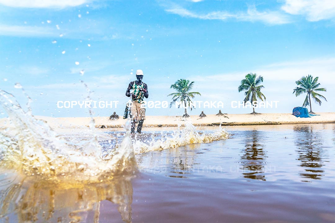 Fisheries and climate change: Fisherman in Ghana casts a net over a lagoon. He had attempted many times without a single catch. He hadn't been to the sea for months due to a decline in fish catch. Ocean warming and acidification are altering marine ecosystems at a fast rate. Freshwater ecosystems are not spared. Climate change threatens livelihoods and food security by altering fish productivity patterns and distribution worldwide. Copyright © 2020 Muntaka Chasant
