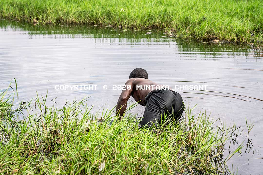 Fishing in Ghana: Urban poor fisherman is fishing in a heavily polluted environment near the center of Accra, Ghana. Copyright © 2020 Muntaka Chasant