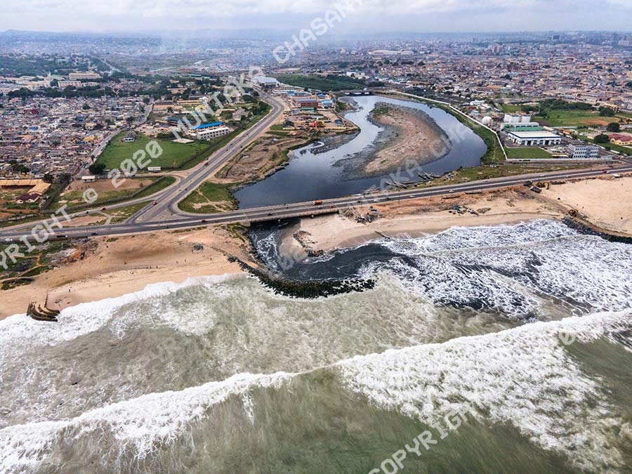 Korle Lagoon Estuary: Aerial view of how the heavily polluted Korle Lagoon empties into the Gulf of Guinea. Copyright © 2020 Muntaka Chasant