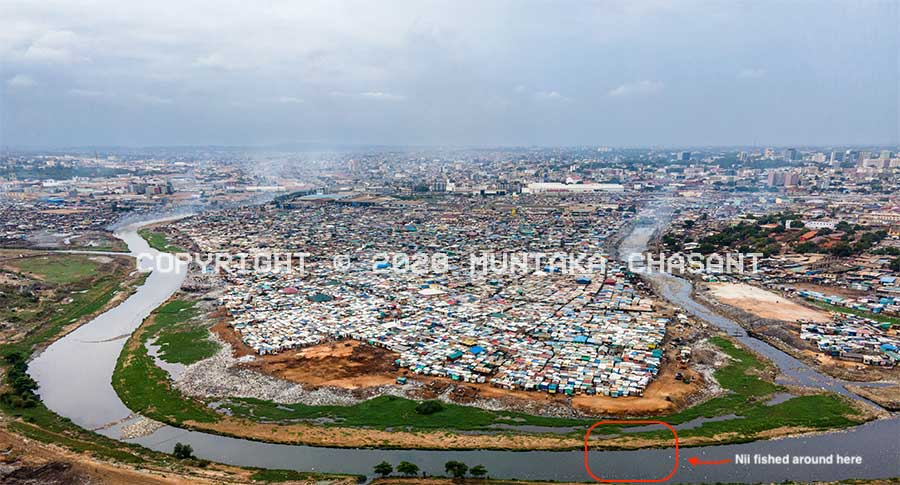 Korle Lagoon: Aerial view of u-shaped Korle Lagoon and the Agbogbloshie drain with Sodom and Gomorrah and other Old Fadama areas in the middle. Accra, Ghana. Copyright © 2020 Muntaka Chasant