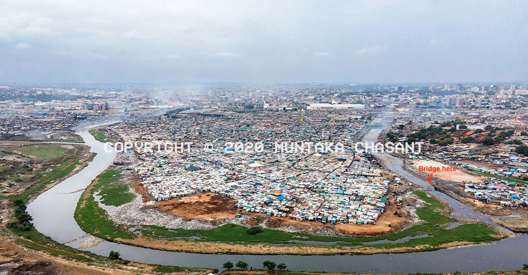 Korle Lagoon and Sodom and Gomorrah Slum: Aerial view of u-shaped Korle Lagoon and the Old Fadama Slum in Accra, Ghana. Copyright © 2020 Muntaka Chasant