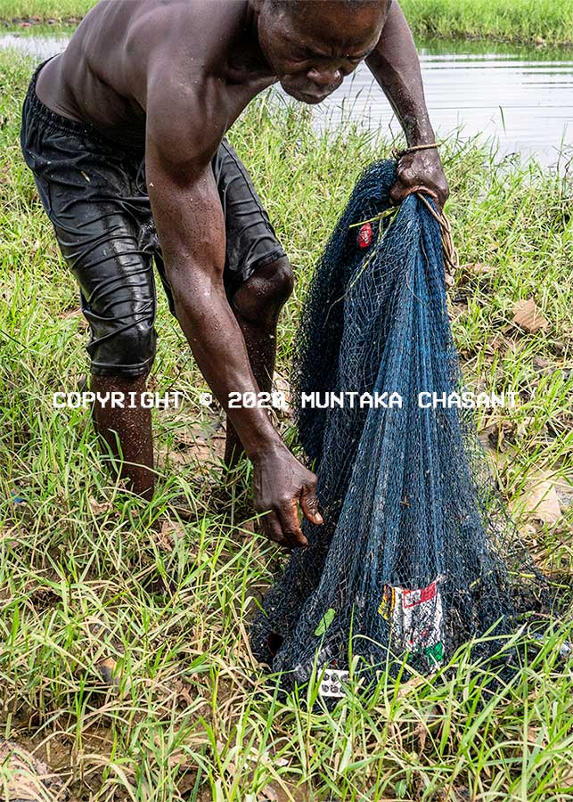 Plastic pollution in Ghana: Poor fisherman fishes in a polluted environment due to catching plastic debris when he goes out to the sea. Copyright © 2020 Muntaka Chasant