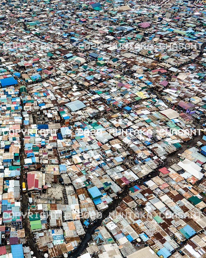 Slum image: Aerial view of the Sodom and Gomorrah (Agbogbloshie) slum in Accra, Ghana. An estimated 80,000 people live inside the Old Fadama slum area, according to United Nations Population Fund estimates. Copyright © 2020 Muntaka Chasant