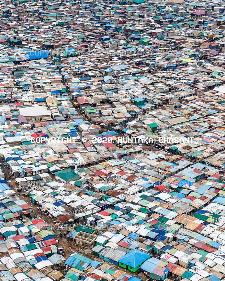 Aerial view of the Sodom and Gomorrah (Agbogbloshie) slum near the center of Accra, Ghana's capital city. Around 80,000 urban poor live in the Sodom and Gomorrah informal settlement. DJI Mavic Air 2 Drone photo sample. Copyright © 2020 Muntaka Chasant