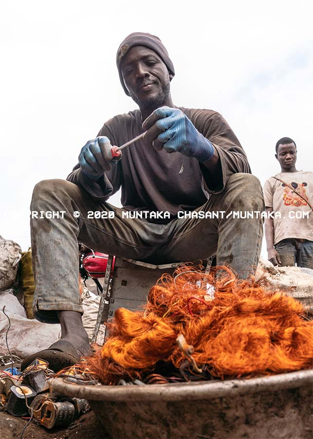 E-waste worker is recovering copper from transformers at Agbogbloshie. Copyright © 2020 Muntaka Chasant
