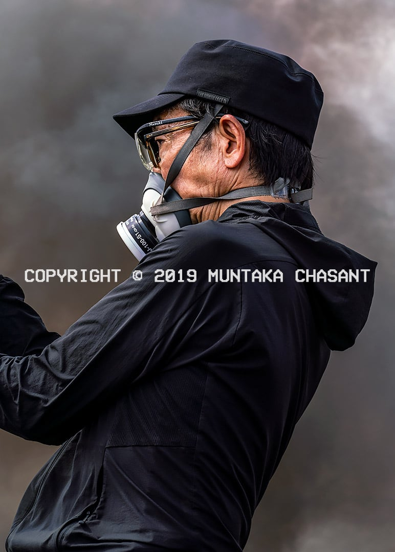Japanese photographer and cinematographer films at Agbogbloshie, Ghana. Copyright © 2019 Muntaka Chasant